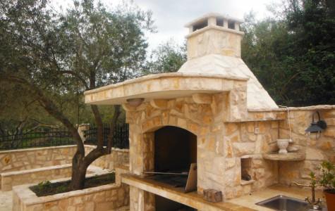 Fireplace construction, stone veneer installation on fireplace